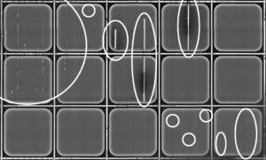 Photolumineszenz-Aufnahme einer Siliziumkarbid-Halbleiterscheibe mit teilprozessierten Bauelementen. Markiert sind auffällige Strukturen, die zu funktionsunfähigen oder im Betrieb unzuverlässigen Bauelementen führen. (Bild: Fraunhofer IISB)