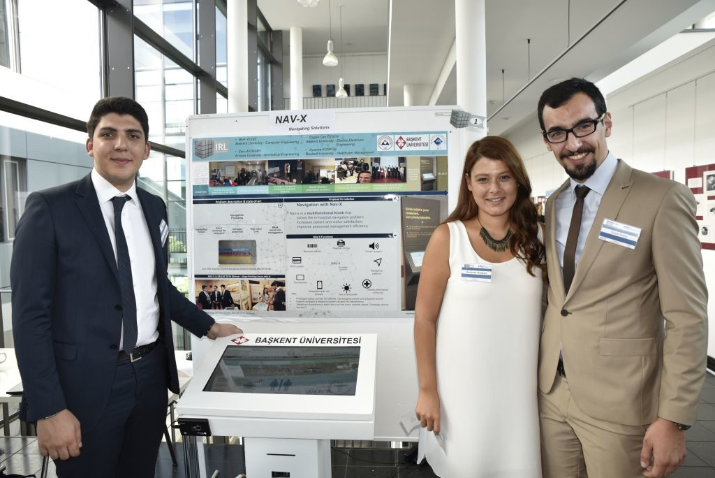 The winners of the Innovation Research Lab Exhibition 2017:the Boğaziçi University team from Turkey, who designed an interactive terminal to facilitate navigation in large hospital complexes.(Picture: FAU/Christina Dworak)