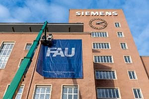 FAU flags are placed on the building.